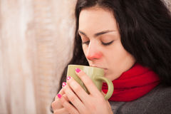 Frustrated sick girl with cup Stock Image