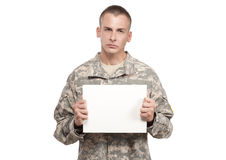Angry Serviceman holding blank sign Royalty Free Stock Photography