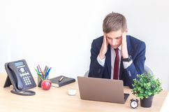 Frustrated stressed business man iat office. royalty free stock photos
