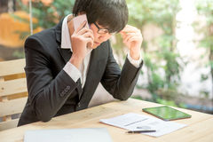 Frustrated stressed business man in workplace Royalty Free Stock Photos
