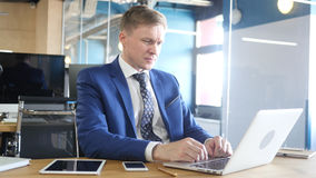 Frustrated and Stressed Businessman Working in Office Stock Image