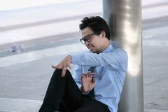 Frustrated stressed young Asian businessman throwing crumpled paper. Depressed business concept. stock photos