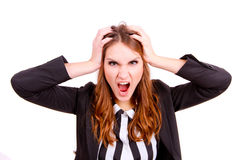 Frustrated and stressed young businesswoman in suit. Isolated Stock Image