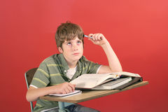Frustrated student at his desk Royalty Free Stock Photography