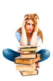 Frustrated student and lots of books Stock Photo