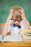 Frustrated student reading books. At the elementary school Royalty Free Stock Photo