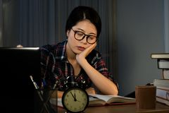 Frustrated student studying poorly. Frustrated tired college student studying poorly sleeping at late night before exam, funny night procrastination concept Stock Photography