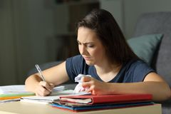 Frustrated student working late hours. In the night at home Royalty Free Stock Photography