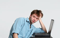 Frustrated teen boy at computer Stock Images
