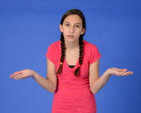 Frustrated teen girl with braids with hands out. Frustrated teen girl with arms at staring in disbelief Stock Image