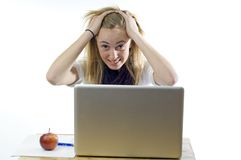 Frustrated teenage girl with laptop computer Stock Photography