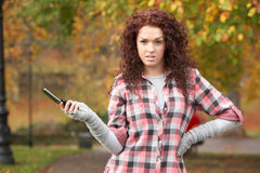 Frustrated Teenage Girl Making Mobile Phone Call. In Autumn Landscape Royalty Free Stock Images