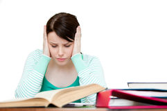 Frustrated teenager doing her homework Royalty Free Stock Photos