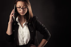 Frustrated teenager girl talking on mobile phone Royalty Free Stock Image