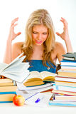 Frustrated teengirl with books tired of studying Royalty Free Stock Images