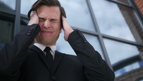 Frustrated, Tense Young Businessman with Headache and Problems. Creative designer , web designer stock video footage