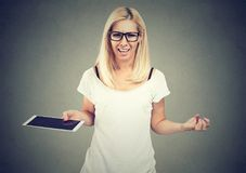 Frustrated unhappy young woman with tablet computer Stock Photo