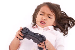 Frustrated, upset, angry little girl gamer experiencing game ove Royalty Free Stock Image