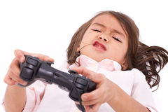 Frustrated, upset, angry little girl gamer experiencing game ove Stock Images