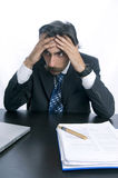 Frustrated, Upset Businessman at His Desk Royalty Free Stock Photography