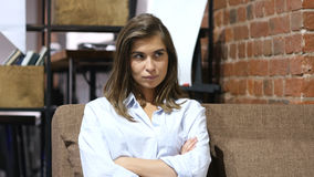 Frustrated Upset Girl Sitting on Sofa in Loft Office Royalty Free Stock Images