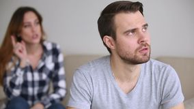 Frustrated upset man turned away ignoring wife arguing blaming husband stock footage