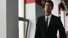 Frustrated, Upset Walking Black Businessman in Office Corridor stock footage