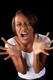 Frustrated woman. A frustrated woman acts out stock photography