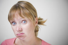 Frustrated Woman. Portait of a bored and frustrated woman stock photos