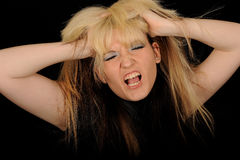 Frustrated Woman. A portrait of a frustrated blond woman, screaming out in anger stock photos