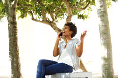 Frustrated woman answering a phone call Stock Photos