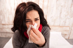 Frustrated woman blowing her nose royalty free stock photo
