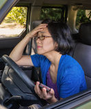 Frustrated Woman in Car in Traffic Jam Stock Photo