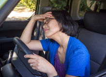 Frustrated Woman in Car in Traffic Jam royalty free stock photography