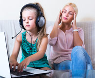 Frustrated woman catching her daughter Royalty Free Stock Photos