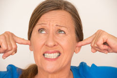 Frustrated woman covering ears Royalty Free Stock Image