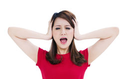 Frustrated woman covering her ears with hands Royalty Free Stock Images