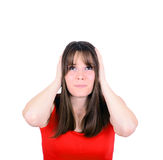 Frustrated woman covering her ears and looking up  Royalty Free Stock Image