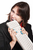 Frustrated Woman Eats Keyboard Stock Photos