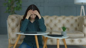 Frustrated woman with expense receipts at home stock footage