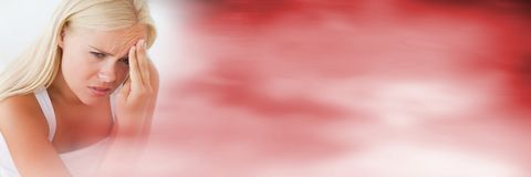 Frustrated woman fingers on forehead and blurry red transition Royalty Free Stock Images