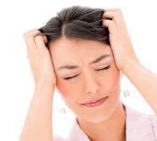 Frustrated woman with a headache Royalty Free Stock Image