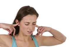 Frustrated woman holding ears Stock Image