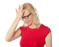 Frustrated woman holding her head Stock Images