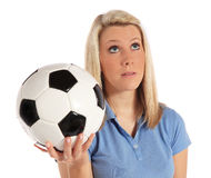 Frustrated woman holding soccer ball Royalty Free Stock Image