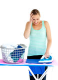 Frustrated woman ironing her clothes Royalty Free Stock Image