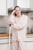 Frustrated woman in the kitchen Stock Photo