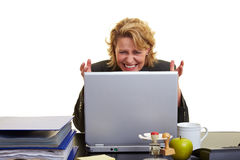 Frustrated woman at laptop Stock Images