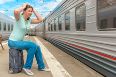 Frustrated woman looking at the passing train Stock Photo