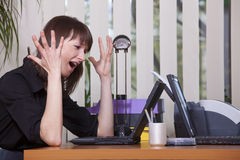 Frustrated woman in office Royalty Free Stock Image